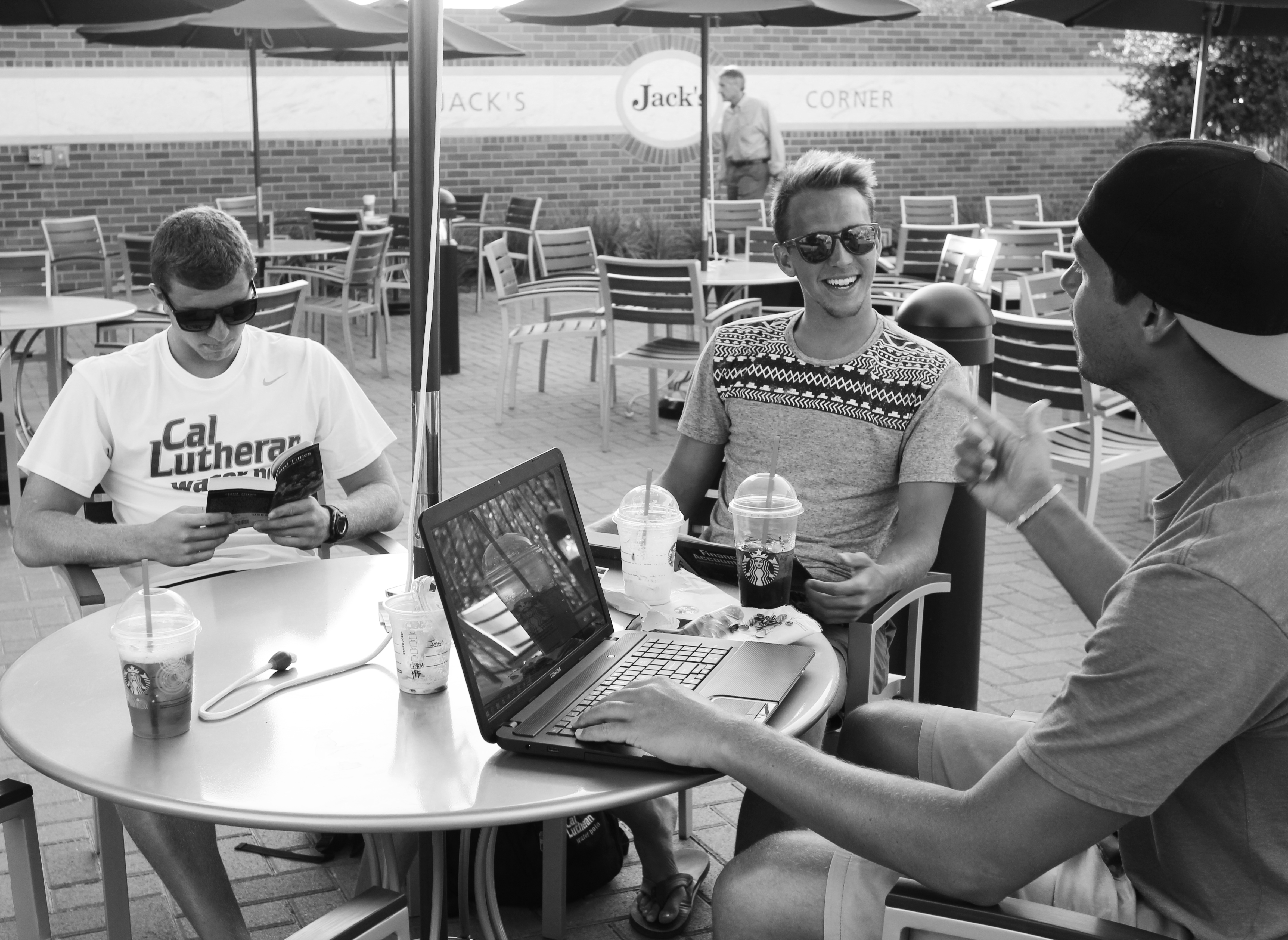 Senior, Jesse Owen, and juniors, Shea Craig and Alex Franklin take a study break at the Starbucks outdoor seating area. Photo by Paulyn Baens – Staff Photographer