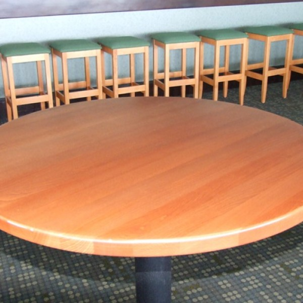 Planked beech wood table tops and cast iron table bases
