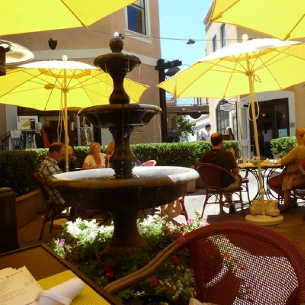 Outdoor gas heaters and patio umbrellas