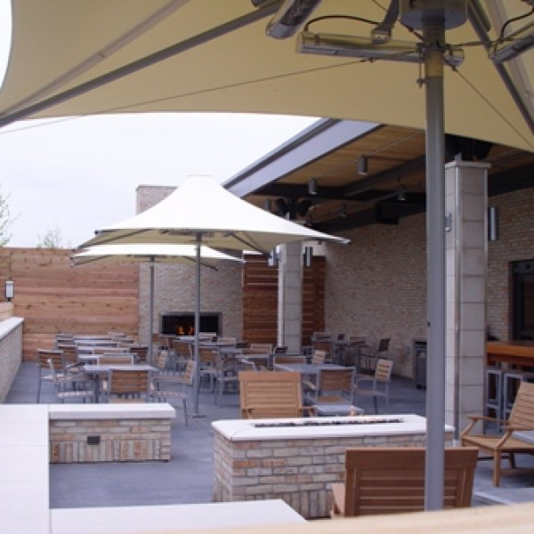 Mediterranean arm chair and heated shade collection for restaurants