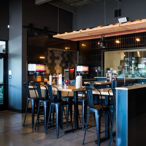 Black Edison Distressed stools throughout the bar area accentuate the industrial look.