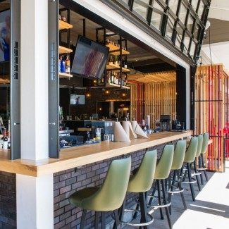 Metal Framed Designer Bucket Barstools around the indoor/outdoor bar area.