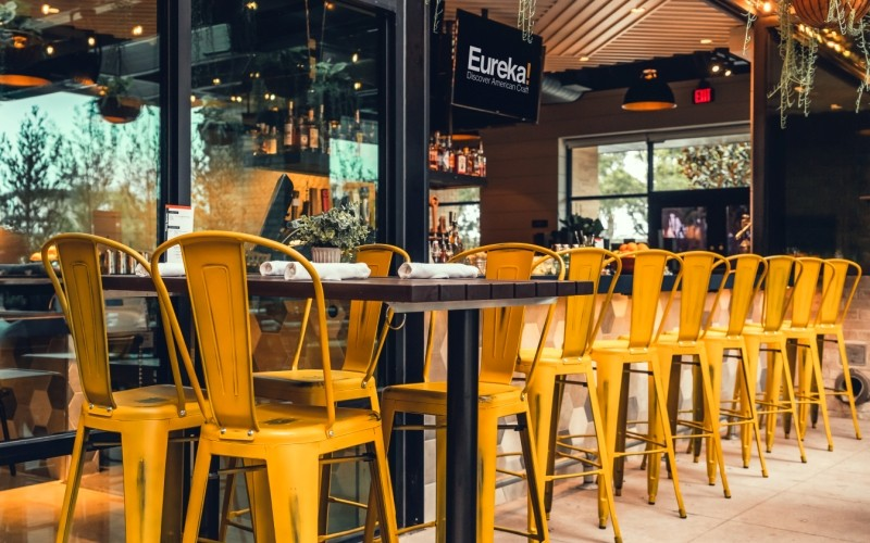 Our Westinghouse Distressed bar stools in yellow create a nice pop of color